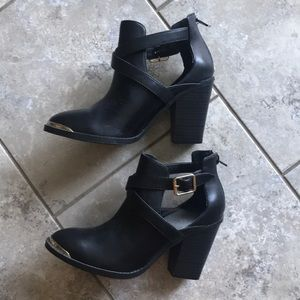 Black and gold cut-out booties
